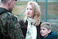 young family and veteran soldier sad